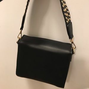 Black mini bag with gold studded strap